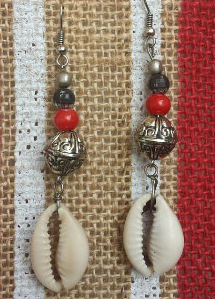 Beautiful custom made Earrings Handmade with metal,cowry shells and beads.