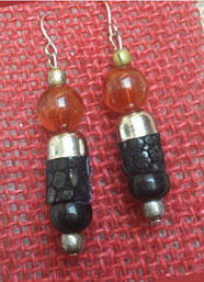 Beautiful custom made Earrings Handmade with metal, Glass and Leather.